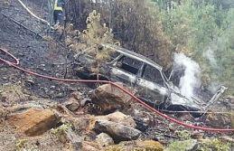 Uçuruma yuvarlanan otomobil yandı 2 kişi yaralandı